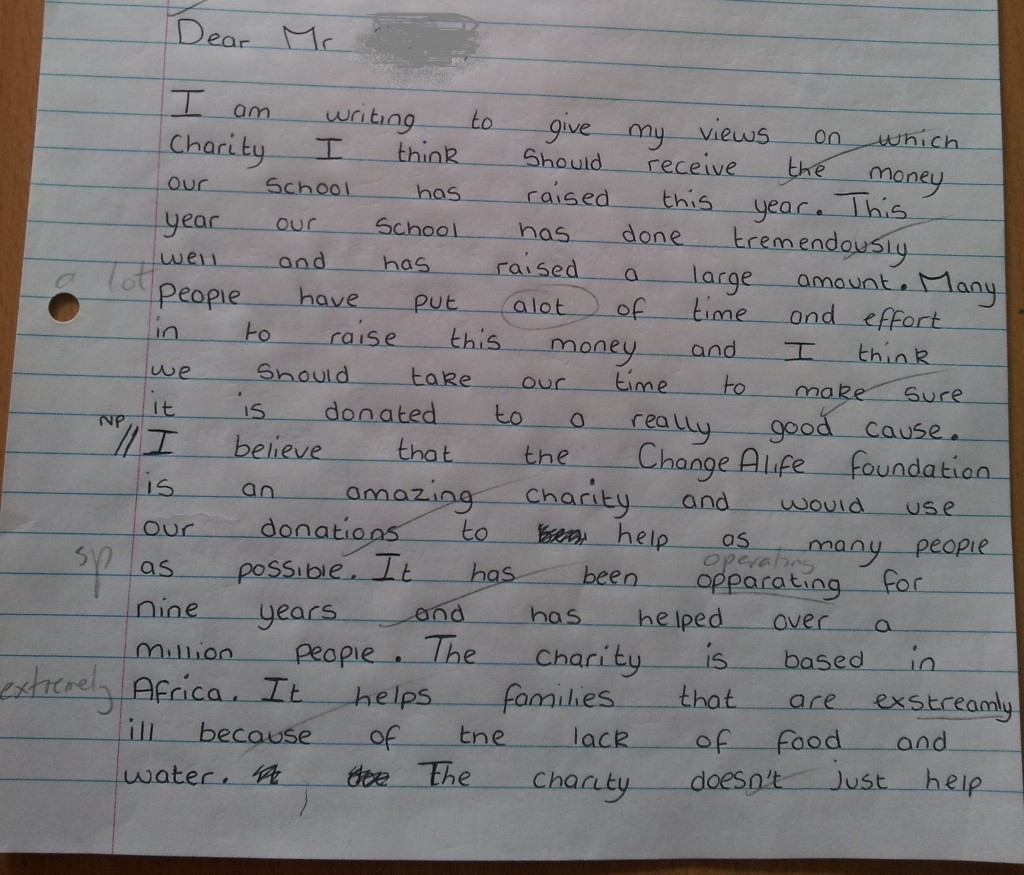Sample of a child's work marked for literacy errors.