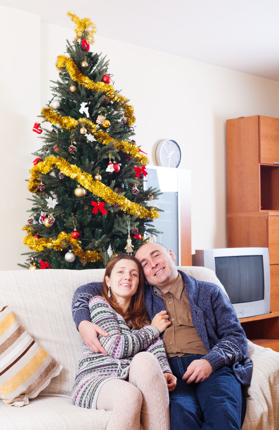 loving couple celebrating Christmas at home